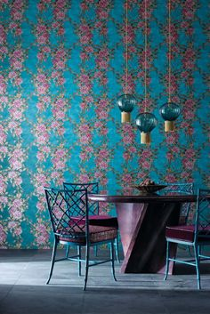 Flamboyant trails of stylised rhododendron like flowers and leaves, create a loose trellis effect on this stunning wallpaper design.