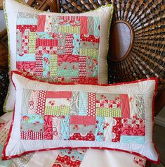 quilted pillows, love the colours, simple post and rail blocks :-)