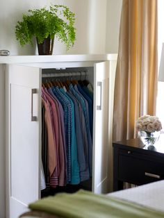 Clever #DIY #Closet Solution ~ In older homes, closet space can be sparse. But with a little clever thinking, you can maximize what you have. Here, wasted dormers are turned into usable built-ins by digging out the space between the wall studs and adding a hanging bar. Now there is storage for clothing, and the exposed part of the cabinet creates a ledge deep enough to display a few trinkets.