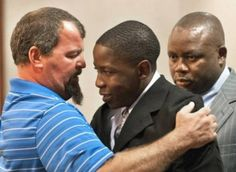 The father of a car accident victim hugging the drunk-driving teen who caused the crash.