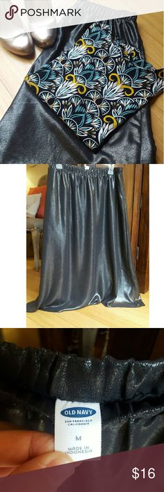 "A-line Skirt Metallic Gunmetal A-line skirt from Old Navy. 16"" waist with elastic. 29 1/2"" long. Double lined. Can be dressed up or down! Worn once and in excellent condition Old Navy Skirts A-Line or Full"