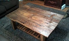 Reclaimed Barn Wood Table.  Inspired by others I have seen online, I decided to have my own barn door table built.  The top is constructed from the barn door. Note the hinge marks (the boards were rearranged) and the hole in the wood where it was grasped and opened.  The slats are old tongue and groove wood from barn #2 and the legs are part of an old wagon. Both barns and wagon are over seventy-five years old.  The gray wood turned this color after the finish was applied.