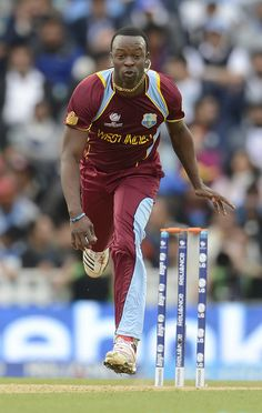 CT13 Match 2 Group Stage - India v West Indies: Kemar Roach follows through after delivering a ball to Shikhar Dhawan.