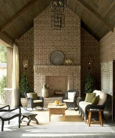 """Great patio decorating ideas can be found here. I love the patio furniture and the layout. Blue stone flooring is carried to the patio. The brick used here was """"White Rose Tudor"""" brick. Lanters are similar to Bevolo Gas Lanterns. Brick Fireplace, Fireplace Design, Brick Walls, Airstone Fireplace, Fireplace Ideas, Outdoor Rooms, Outdoor Living, Outdoor Decor, Outdoor Kitchens"""
