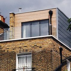 Like the combination of yellow brick, cedar cladding and grey tiles on the right