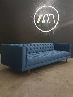 Modern Chesterfield Style Sofa with Vintage Flare