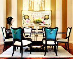 A pop of blue silk on the back of these dining chairs is in dramatic contrast to the cream leather.