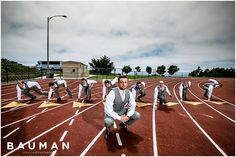Epic shot of the groomsmen on the track.   Liberty Station Wedding :: San Diego, CA Photography by Bauman Photographers.  View More:  http://baumanphotographers.com/blog/weddings/2013/07/liberty-station-wedding-san-diego-ca/