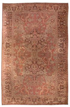 A finely-woven early 20th century Turkish Hereke antique carpet, the dusty rose field with dramatic flowers and leafy blossoms around a central flower with two enormous unusual burgundy pendants, which are linked to ivory spandrels within a burgundy vinery border. Watch full size video of A Turkish Hereke carpet, Circa 1900, ID BB0782 - Video