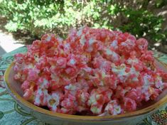 Sweet Pink Popcorn from Food.com: This is sweet buttered popcorn with red food color added. Great for a girls birthday party or for Breast Cancer Awarness events.
