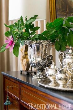 Silver Tea Service and a silver urn sit atop a dining room sideboard. - Photo: John Bessler / Design: Lisa Hilderbrand with Sarah Hamlin Hastings
