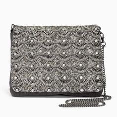 Add a little extra detail to your party outfit this festive season with our stunning silver beaded clutch bag.