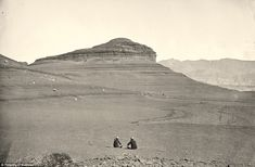 Fabulous pix of the old West, by Timothy O'Sullivan, from the 1860's & 1870's.  Barren: Two men sit looking at headlands north of the Colorado River Plateau in 1872