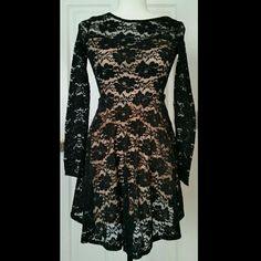 NWT Black lace over light pink skater dress Long sleeve black lace over sweetheart nude pink underdress. Club L Dresses