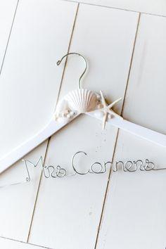 Pretty modern beach bride wedding dress hanger