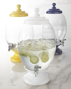 """Beverage Server holds 2.2 gallons made of glass and ceramic, 9""""Dia. x 18""""T 