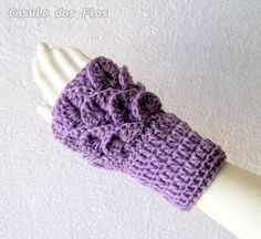 Par de luvas sem dedos (tipo polainas de mão) que podem ser usadas como punho também. R$ 35,00