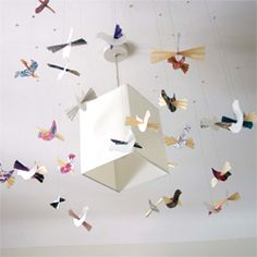 Easy make - paper bird mobile. Lovely way to inject colour and life into a room.