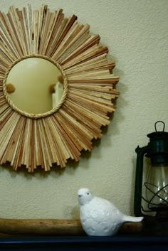Shim sunburst mirror; love how the rope adds a rustic touch