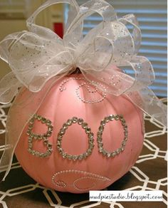 well a pink pumpkin with a bow on it is a must do...all sparkly