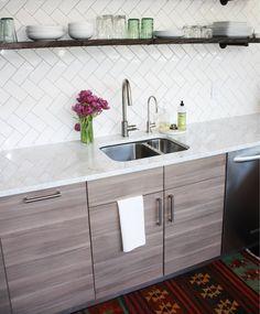 very pretty kitchen.  Love the herringbone tile.