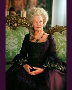 The magnificent Dame Judi Dench, sporting an awesome do.