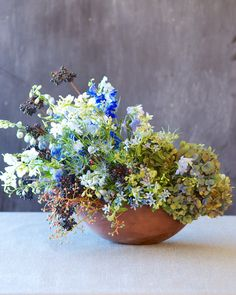 Kiana Underwood / tulipina.com. Flowers: delphinium, belladonna, privet berries, hydrangea, thistle, viburnum, tweedia