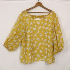 "Sunshine yellow sheer floral bow back peasant top Excellent condition! Fabric is folded at seams and bow which causes slight dark dots. Please see photo three. This is not a stain or discoloration. No brand or size tag present. Brand is Mark Edwards, a Canadian retailer. Sheer chiffon lining at front of top, sheer at sleeves and back. Since no size is present, please see measurements!  bust 41"" lower him 47"" length 24"" Mark edwards Tops Blouses"