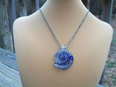 Brilliant Blue Spiral Glass Necklace by BirdysNest on Etsy, $18.00