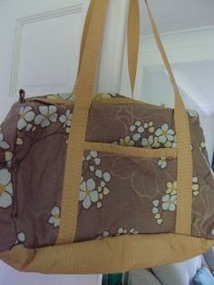 A large totally unique weekender bag.In mid brown floral material with contrasting straps and lining. Approx 17 inches long 12 inches high and 6 inches wide at the base. Free Motion Embroidery, Brown Floral, Weekender, Mustard, Diaper Bag, Shoulder Strap, Handmade Items, Base, Zip