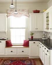 They personalized the look with leaded-glass inserts, aged-bronze bin pulls, and scrolled corbels. Another money-saving trick: As an alternative to a single piece of stone for the countertops, they opted for 12-by-12-inch granite tiles that they installed with dark grout. The effect is the same, at a fraction of the cost.