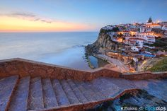 """Azenhas do Mar - <a href=""""http://www.facebook.com/sysaworld""""> My Facebook Page ✔ </a> --- <a href=""""http://www.sysaworld.com/""""> My Website ✔ </a> --- <a href=""""http://stock.clickalps.com/photographer/Roberto-Moiola""""> My Online Stock ✔ </a> --- <a href=""""https://plus.google.com/u/0/+robertomoiola""""> My G+ ✔ </a>  Not far from Lisbon and close to the famous Sintra there is a small paradise hold on in the rocks: Azenhas do Mar. Here the cliffs try to defend themself by the incessant puffs from the…"""