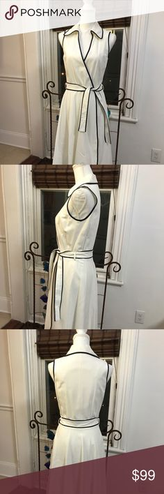 VINTAGE NEIMAN MARCUS White & Navy Wrap Dress Very feminine & classic wrap shirt dress.  Beautifully lined.  Linen white with navy piping trim.  Vintage 90's in very good condition. Neiman Marcus Dresses Midi