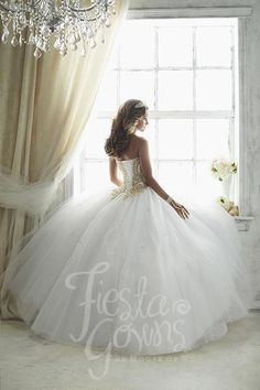 A true eye-catching quinceañera gown made with shining embroidery and emblazed with stones. Download the Fiesta Gowns by House of Wu sizing chart here. *Note lead times for dresses will vary. All item More