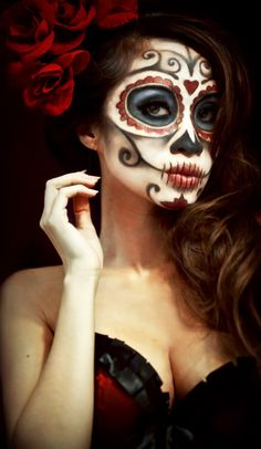 the darkness in her eyes can only barely hide the truth only the dead know. and those roses though - so classic Catrina
