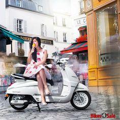 Scooter Girl with Icecream. Peugeot Django Heritage 150.