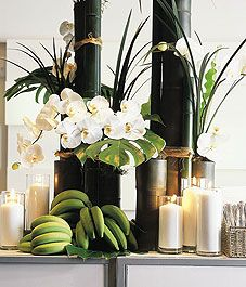 Love this display  with Phalaenopsis orchids, Exotic greens and those green bananas make this setting awesome!