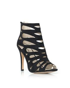teardrop cut-out detailing on these open toe heels lends feminine flair to a bold caged style.