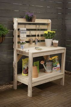 Potting bench with open slats on hutch for hanging tools