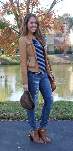 Navy and white striped shirt, jeans, brown leather jacket, brown booties