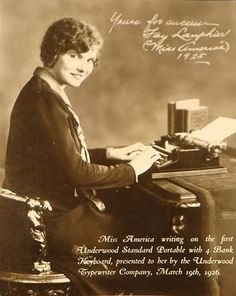Fay Lanphier, the 1925 Miss America from Oakland is letting us know what she thinks of her new typewriter.