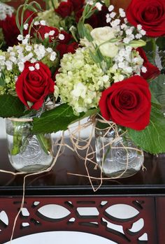 when classic color meets old fashioned style; red roses, green hydrangeas & babies  breath in mason jars