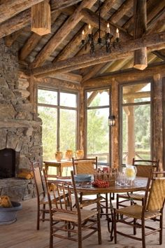 The screened in porch in this Montana log home.