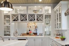 Country Kitchen with Kitchen island, Complex Marble, Wine refrigerator, Flush, Flat panel cabinets, Pendant light, L-shaped
