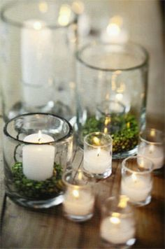 mix sizes of candles and votives and add a little greenery