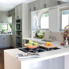 Kitchen Peninsula with Integrated Gas Cooktop and Waterfall Counter