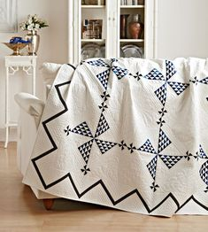 An abundance of tiny pieces, an unconventional border, and stunning quilting add… Two Color Quilts, Blue Quilts, Kid Quilts, Ribbon Quilt, Black And White Quilts, Black White, Pinwheel Quilt, Quilt Border, Antique Quilts