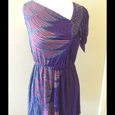Unique Dress FREEPEOPLE Beaded Purple XS Unique Dress; only worn 1x, excellent used condition! Fun & Sexy! Dress bY FREE PEOPLE Beaded detail on top left. Feather print - colors are purple, pink, & blue.  Elastic around waist to accentuate.  100% viscose.  XS Free People Dresses