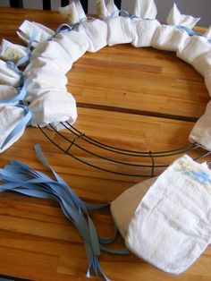 baby shower diaper wreath - just add toys and things, maybe a hanging pic of mom/dad in middle...this is so much cuter than a diaper cake!