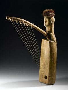 Africa | Harp (ngombi) from Gabon | Late 19th century | Cottonwood, skin, cut and wood